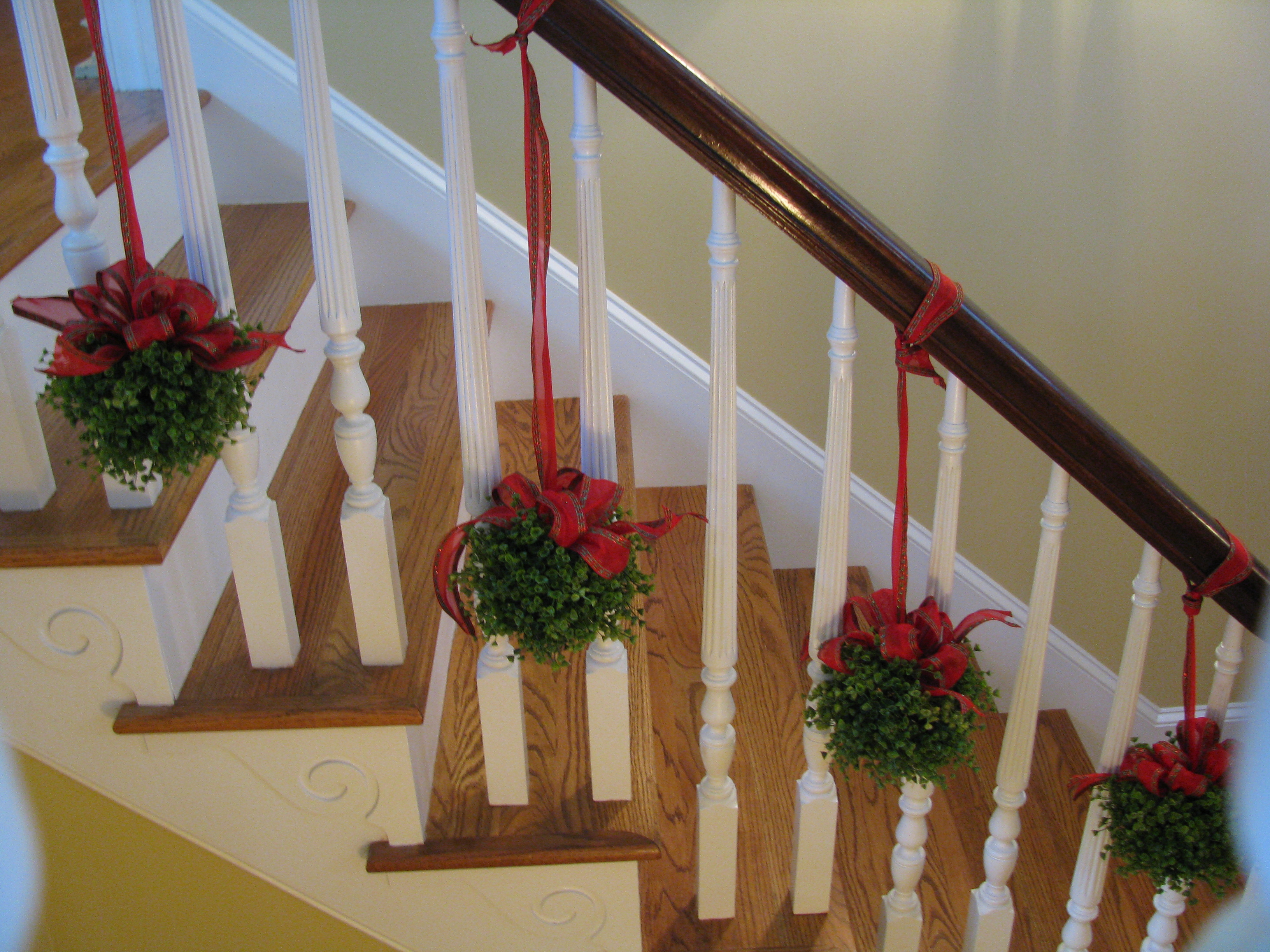 Topiaries on the stairs for Stair railing decorated for christmas